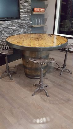 Shelly arent these the stools u just got? Winnipeg Jets Whiskey Barrel Pub Table by PubnBarrel on Etsy Whiskey Barrel Table, Wine Barrel Table, Wine Barrel Furniture, Bar Furniture, Rustic Furniture, Wine Barrels, Barrel Sink, Automotive Furniture, Automotive Decor