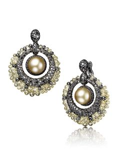 De GRISOGONO 20th anniversary high jewellery earrings in white gold and titanium, set with two gold pearls and black and yellow diamonds.