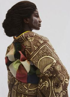 "African Kimono by Serge Mouangue Cameroonian-born, Tokyo-based designer Serge Mouangue. Blessed to have his designs showcased in Senegal and in Japan.  In his own words, ""I pursue and observe the complexity of different values and cultural identities in search of threads to weave a fabric which is a blending of these differences.It is not a fusion,I want it to be something else. It should transcend the boundaries of both""cultures. It is a third aesthetic."""