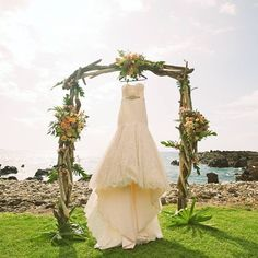 Driftwood wedding arch adorned with peach and sunshine florals by Petals -- gorgeous strapless wedding gown -- Anna Kim Photography