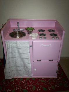 Flickr play kitchen group: Curbside Cabinet After: Little Pink Kitchen - Flipped, cut apart doors, painted and detailed.