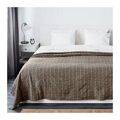 TALLÖRT Päiväpeitto IKEA Puuvillan sekaan on kudottu paksumpaa juuttilankaa, mikä tekee pinnasta elävän.