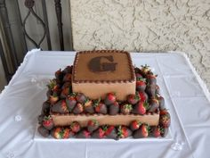 Two tier chocolate grooms cake with strawberries. By dacakeldy on CakeCentral.com