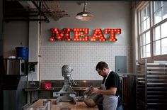 MEAT lit sign