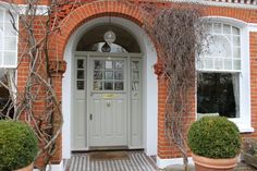 A putty coloured Edwardian front door...from How To Choose The Perfect Front Door Colour For Red Brick Houses on Modern Country Style