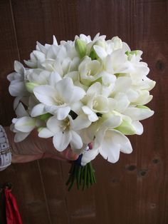 Pretty and scented white freesia bridesmaids bouquet , very light weight