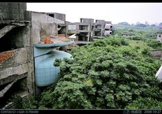 San Zhi is an abandoned vacation resort on the northern coast of Taiwan. It was built in the early 1980s, but construction of the futuristic resort ceased after a series of fatal accidents. Even though it never opened as a vacation resort, San Zhi can still be toured. The strange pod-like buildings act as a tourist attraction.