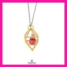 Handmade gold plated silver polygon pendant with red Swarovski crystal inside it, on black rodium sterling silver thin chain. A modern and unique jewelry.-----------------------------------------------------------------Χειροποίητο ασημένιο κολιέ Swarovski πολύγωνο από επιχρυσωμένο ασήμι και κόκκινο κρύσταλλο Swarovski που κρέμεται στο κέντρο του, Το μενταγιόν είναι περασμένο σε λεπτή αλυσίδα από ασήμι με μαύρο πλατίνωμα. Ένα πρωτότυπο κόσμημα για ξεχωριστή παρουσία.