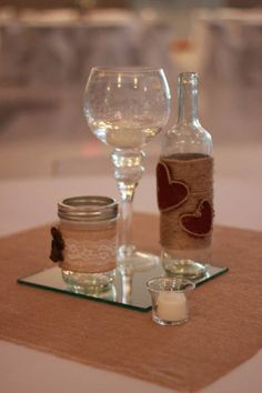 twine wrapped wine bottle and mason jar country chic wedding center piece.