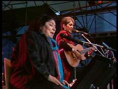 "▶ Joan Baez & Mercedes Sosa-- ""Gracias a la vida"" (composed and first performed by Chilean Violeta Parra) Thanks to life, that has given me so much...."