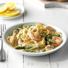 My kids love this creamy pasta. Whenever I make it, I know that they will happily clean their plates. —Joe Milholland, Smelterville, IdahoChicken and Shrimp with Lemon Cream Sauce Recipe photo by … Seafood Recipes, Pasta Recipes, Chicken Recipes, Cooking Recipes, Dinner Recipes, Meat Recipes, Dinner Ideas, Recipies, Lemon Cream Sauces
