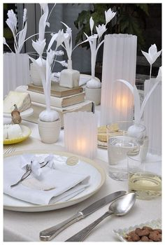 Smart inexpensive way to dress up a table...project vellum courtesy David Stark