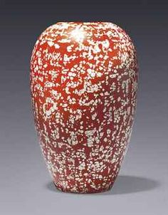 JEAN DUNAND (1877-1942) A VASE, CIRCA 1925 lacquered metal, inlaid with eggshell signed in lacquer Jean Dunand 9½ in. (24.2 cm.) high