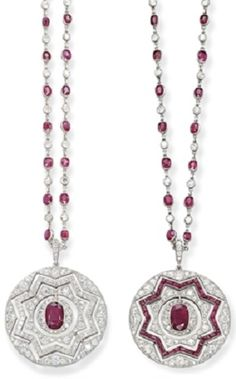 A VERSATILE ART DECO RUBY AND DIAMOND PENDENT SAUTOIR. The openwork circular pendant of star motifs, either entirely set with diamonds or with a reversible calibré-cut ruby star, centring upon an oval-shaped ruby within a pavé-set diamond surround, to the spectacle-set ruby and diamond neckchain, mounted in platinum, circa 1930. #ArtDeco #sautoir #necklace