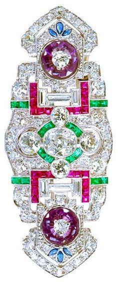 An Art Deco diamond and gem-set brooch. Set with antique cut diamonds, emeralds, rubies, and hand carved petal shaped amethysts, mounted in platinum. #ArtDeco #brooch ♥•♥•♥