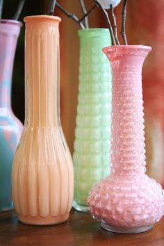 Inexpensive glass vases, etc...paint insides to match your décor!  (Get the glass pieces at garage sales for next to nothing!!!)
