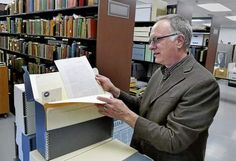 Greg Williams, Director of Archives and Special Collections at CSUDH, looks over a few of over 10,000 documents and oral histories gathered from 15 CSU campuses that will be archived in one database for research. Photo by Brad Graverson/The Daily Breeze/6-23-15 CSU system will digitize experiences of Japanese-American World War II internees