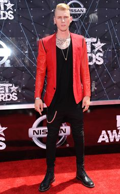 Machine Gun Kelly from 2015 BET Awards: Red Carpet Arrivals  The rapper goes for a bold red blazer, slim-fitting pants and combat boots on the red carpet.