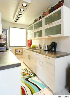 nice cabinets and pulls, cool rug and lighting