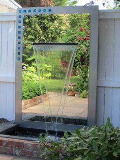 fontaine de jardin et miroir trompe l'oeil