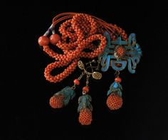 Chinese coral enamel Kingfisher feather necklace set. Worn as symbol of wealth and status in the Mandarin court about 150 years ago, the brilliant blue of rare kingfisher feathers contrasts with the red beads made from coral imported from Italy