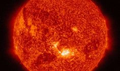 NASA SDO: Images of a mid-level solar flare - NASA's Solar Dynamics Observatory captured this image of a mid-level solar flare on the sun - as seen in the bright spot in the lower center of the solar disk on Aug. 24, 2015. The image shows a subset of extreme ultraviolet light that highlights the extremely hot solar material, which is typically colorized in red. Credit: NASA/SDO