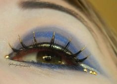 Unique gold tip lashes with blue grey gradient eye shadow enhanced with gold crystals by MUA Krissii.