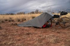 Ultimate Direction Bike Tarp Conversion Kit creates a bicycle-supported shelter - Bikerumor Backpacking Tent, Tent Camping, Outdoor Camping, Outdoor Gear, Touring Bicycles, Touring Bike, Lightweight Tarp, Waterproof Tarp, Tarp Shelters