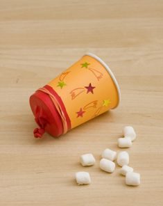 Make a Mini-Marshmallow Popper. Try to pop marshmallows into a box or bowl. Use colored marshmallows for groups.