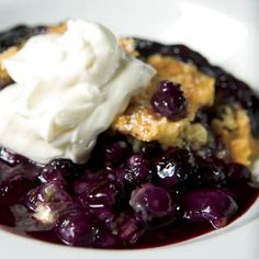 Blueberry Dump Cake -4 c. frozen blueberries,  ½ cup sugar,1 box yellow cake mix,  1½ sticks butter,  whipped cream or vanilla ice cream  Dump blueberries and sugar into 9x13-inch baking dish. Stir together.  Sprinkle cake mix over the fruit.  Slice butter and distribute over the surface of the cake mix.  Bake at 350  45 min to 1 hour.