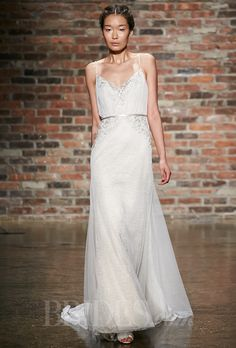 Brides.com: Alvina Valenta - Spring 2014. Style 9409, ivory English net and Chantilly lace over champagne charmeuse slim wedding dress with blouson bodice, sheer sweetheart neckline, beaded spaghetti straps and embroidered and jeweled accents throughout, Alvina Valenta