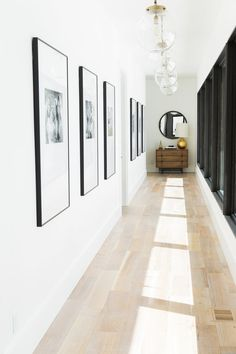 Studio McGee | Our Favorite Ways to Incorporate Family Photos-I love this for our hallway.