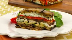 Vegetable Goat Cheese Terrine - Recipes - Best Recipes Ever - A slice of this cool vegetarian terrine is heavenly on a warm evening. With layers of eggplant, zucchini, red pepper and goat cheese, this dish is easy to make and very impressive. You can use two different coloured sweet peppers for a really dazzling presentation.