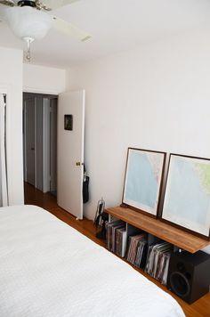 Low slung shelf from plastic crates + 1 wood board + 2 large framed maps.  Olivia's Elegant Oakland Apartment