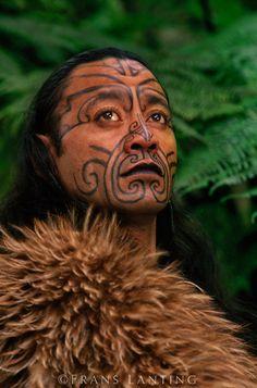 Maori man in kiwi cloak with Moko facial tatooes, Rotorua, New Zealand   © Frans Lanting