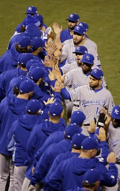 The Kansas City Royals celebrate after Game 3 of baseball's World Series against the San Francisco Giants Friday, Oct. 24, 2014, in San Francisco. The Royals won 3-2 to take a 2-1 lead in the series. (AP Photo/Eric Risberg)