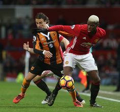 Paul Pogba of Manchester United in action with Lazar Markovic of Hull City during the Premier League match between Manchester United and Hull City at...