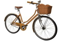 I've always wanted a bike with a basket in front, for wild flowers, or brown paper packages.   Lady Milano