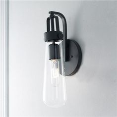 Bulb Glass Vial Wall Sconce Blending modern aesthetic with industrial-chic design, this vial-shaped clear glass is suspended by a Brushed Nickel or Black industrial bracket. I would prefer this in brass. Black Wall Sconce, Vintage Wall Sconces, Rustic Wall Sconces, Bathroom Wall Sconces, Candle Wall Sconces, Wall Sconce Lighting, Master Bathroom, Fresco, Sconces Living Room