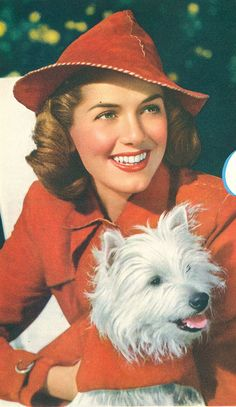 Such a great red ensemble from 1939 (I especially like that fun, casual hat). #vintage #1930s #fashion #dogs
