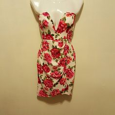 Gorgeous deep v neck dress NWT FINAL PRICE This one is a show stopper, beautiful roses are the main attention grabber while the skirt is medium length has a very flattering shape, has wires at the cleavage for extra hold.THIS IS FINAL  PRICE SO PLEASE NO OFFERS! TY! Dresses Strapless