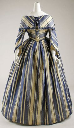 Dress ca. 1850.  Striped textiles were extremely popular in women's mid-1800's daytime wear, although they were almost never used in evening garments.
