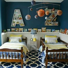 I love this shared room - the rug, bedding, chair rail, and dark blue paint.