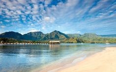 Hanalei Bay in Kauai is a heart-stopping bay backed by 4,000 foot emerald mountains.