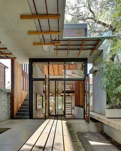 Jungle House by Drew Heath in Sydney, Australia: old cottage and new structure tethered by open air corridor //