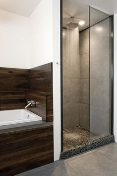 shower-why not make it look more natural...add tile that looks like rocks or add sand colored floor tile and flagstone walls?