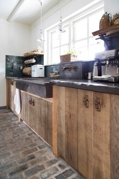 Awesome sink and faucet.  Also like the cement countertops, shelves, and wood doors