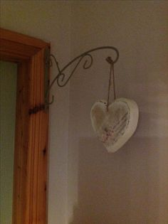 I covered these heart in off white chalk paint, stuck on a paper I love, rubbed the edges down light with a damp cloth and they now hang outside my rooms up on a wall hanger , not sure if it needs more.... Maybe one day, but for now I like them how they are.