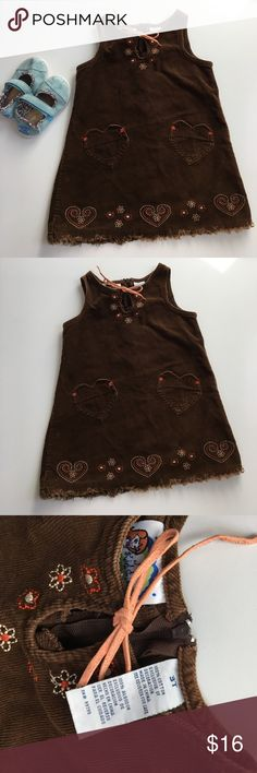 """Corduroy dress Cute corduroy dress with sewing accents and cute heart pockets, tie at neckline, half zipper down back. Previously worn with normal wash and wear. In good condition. Measures laying at approx 12"""" pit to pit 17.75"""" shoulder strap top down. Dresses"""