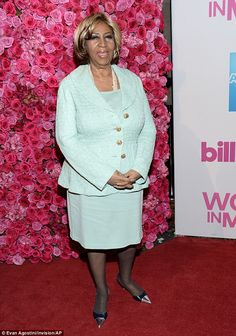 Legend: Aretha Franklin was stylish in a powder blue suit as she posed for the cameras...